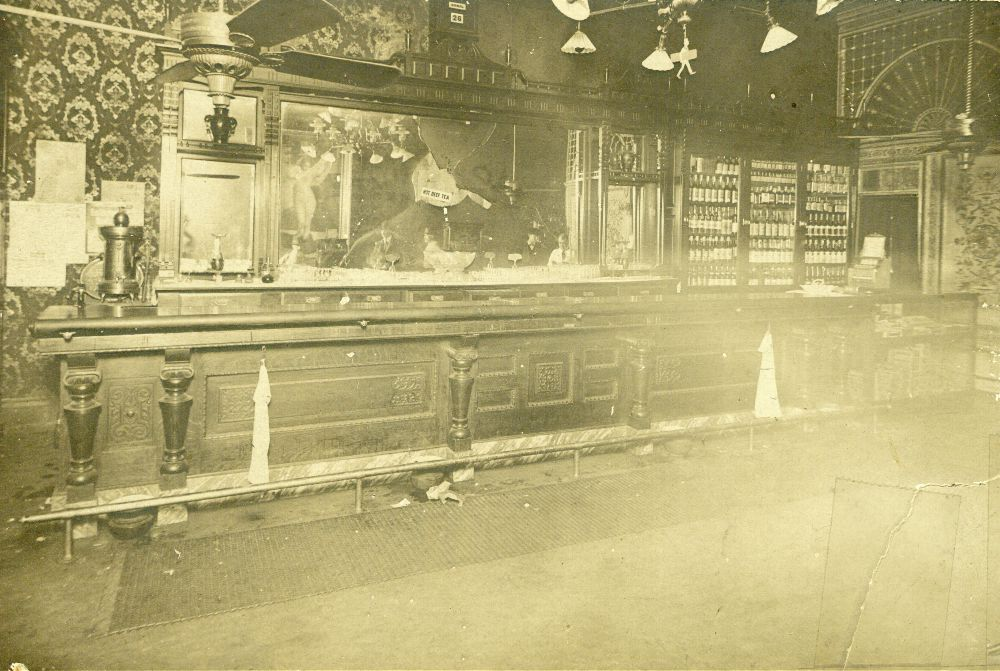 From Kansas Memory:  A photograph showing the Carey Hotel Bar in Wichita, Kansas after Carry Nation threw rocks to break the mirror during a temperance protest, December 27, 1900.  Kansas Historical Foundation