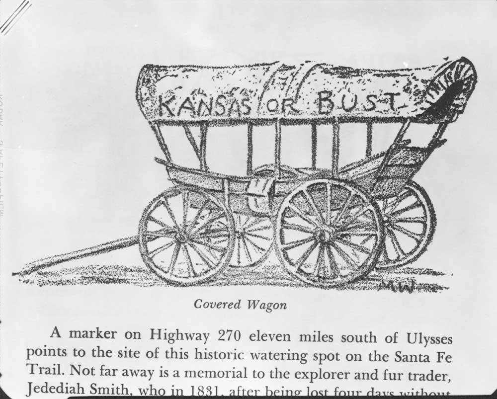 """Covered wagon with wording """"Kansas or Bust"""""""