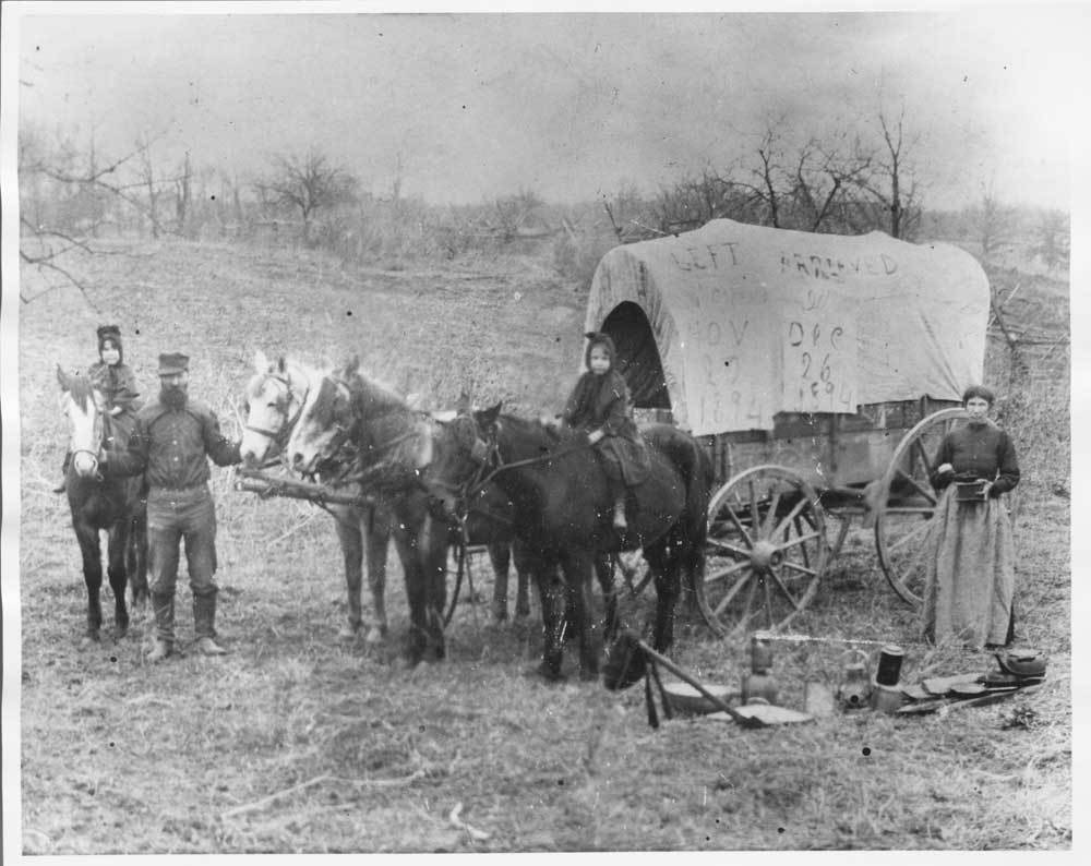 W.L.K. Owen and family in their covered wagon
