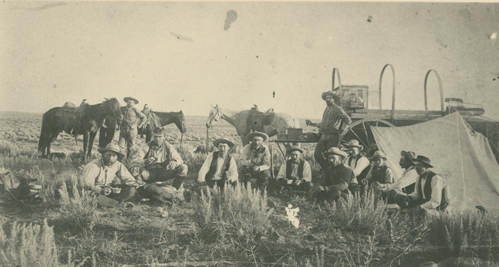 Cowboys at a chuck wagon