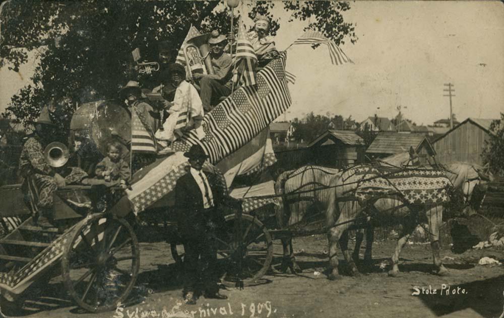 Clown band and bandwagon, Sylvan Grove, Kansas