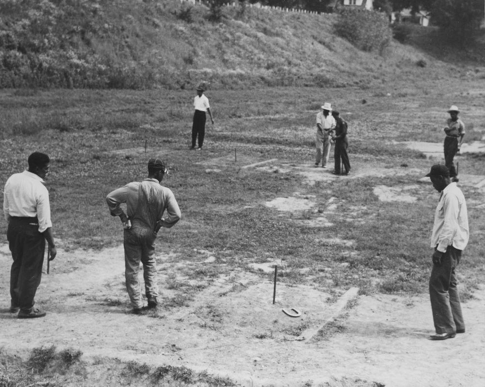 African American men playing horseshoes, Kansas City, Kansas