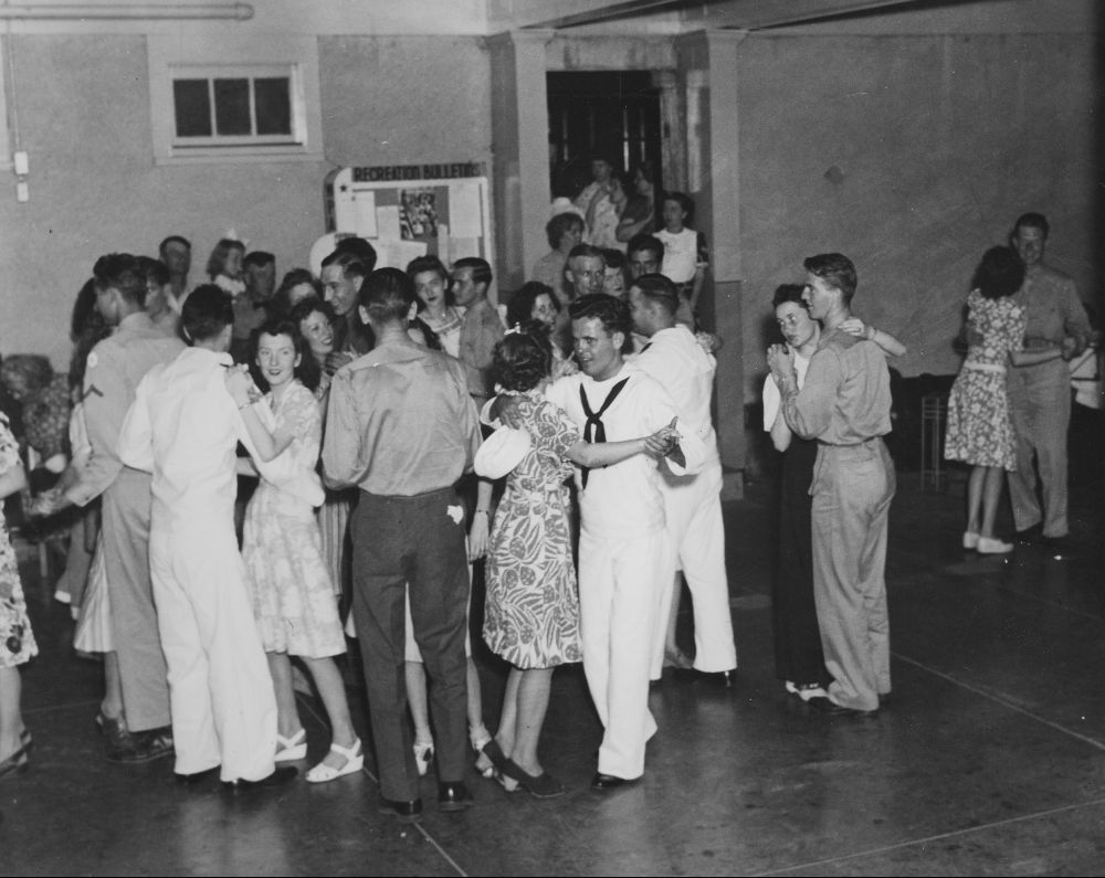 Soldiers and sailors dancing