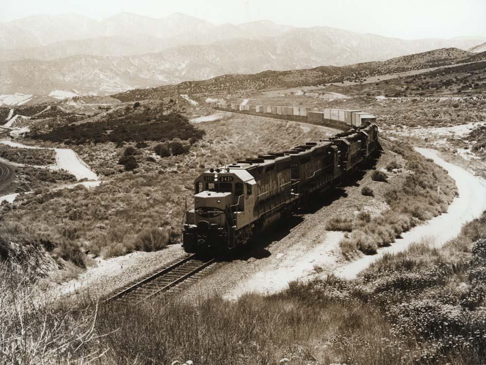Diesel-powered locomotive and freight train, Cajon Pass, California