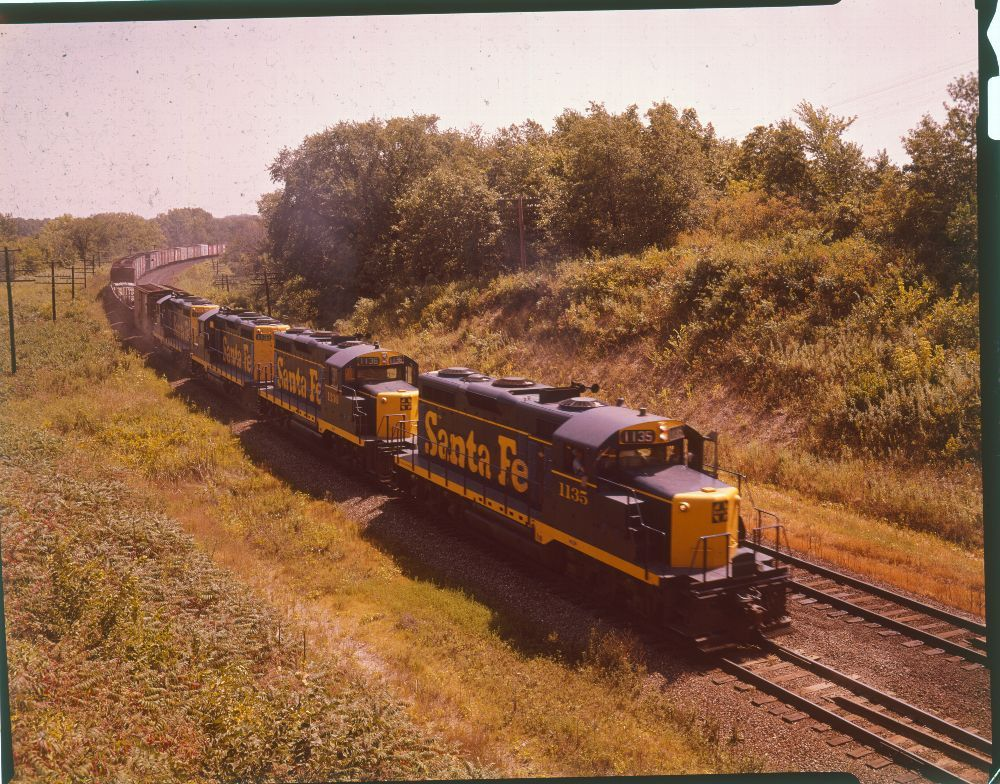 Atchison, Topeka & Santa Fe  Railway freight train pulled by engines #1135 and 1136