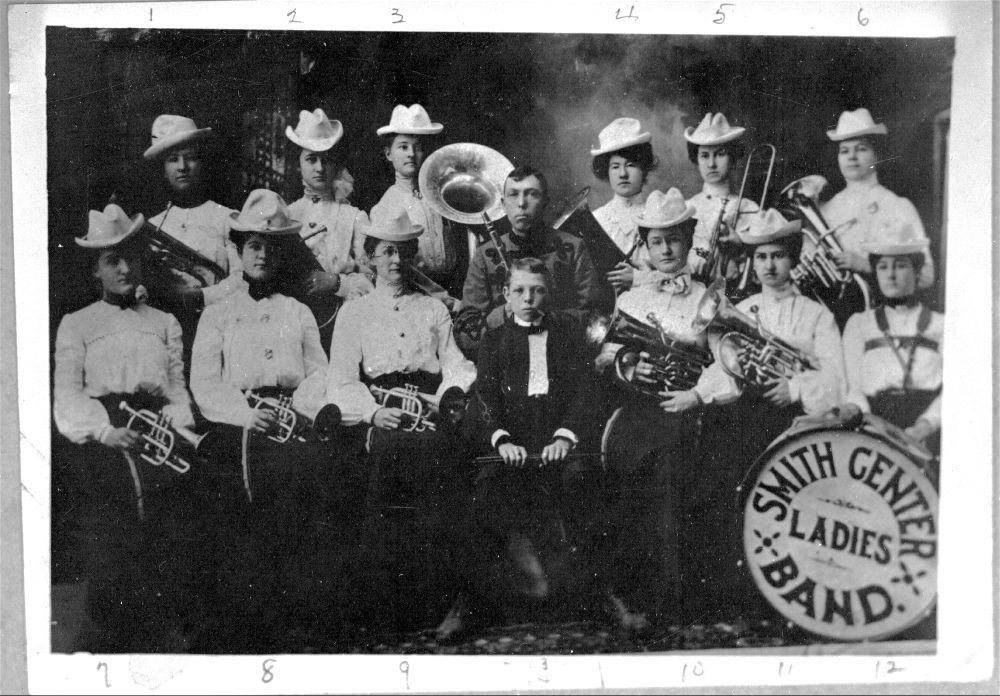 A studio portrait of the members of the Smith Center Ladies' Band of Smith Center, Kansas, between 1880 and 1900.