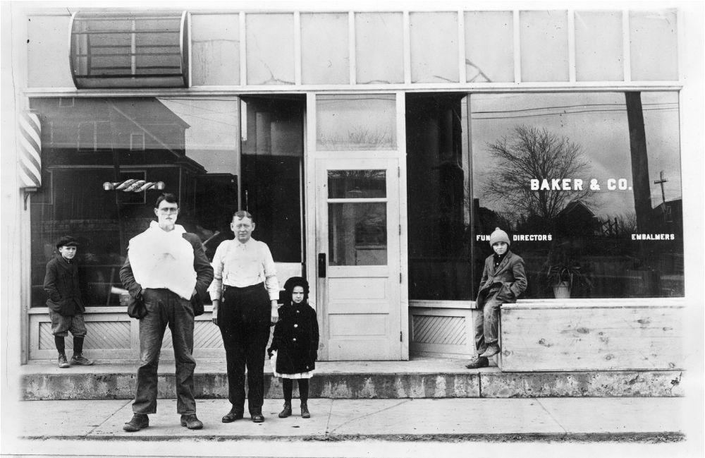 Baker & Co. funeral home and unidentified barber shop, De Soto, Kansas