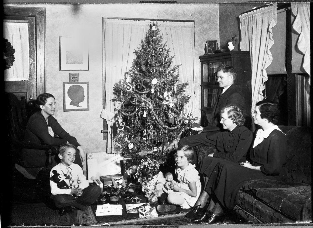 Family around a Christmas tree