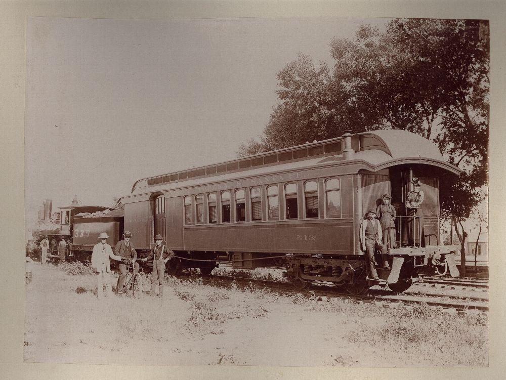 John Christoph photograph album - An Atchison, Topeka & Santa Fe Railway passenger train, possibly photographed in Ellinwood, Kansas.