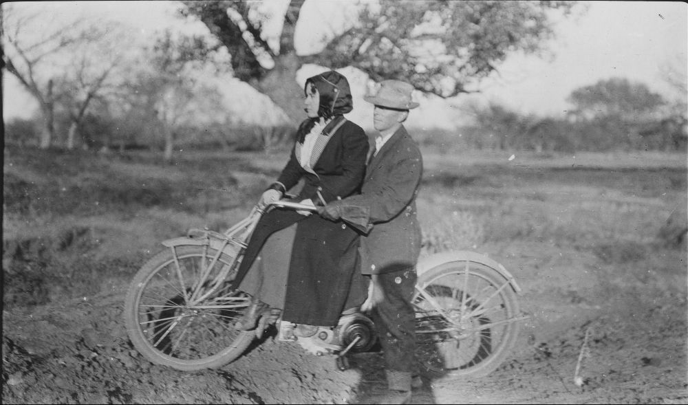 Man and woman sitting on a motorcycle