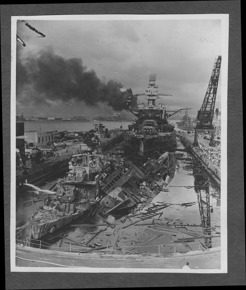 Attack on Pearl Harbor, Hawaii - Destroyers USS Downes (left) and USS Cassin (right) were battered by aerial bomb hits.  After the attack, machinery and other fittings from the two destroyers were transferred to new hulls and the ships were back on the active list.