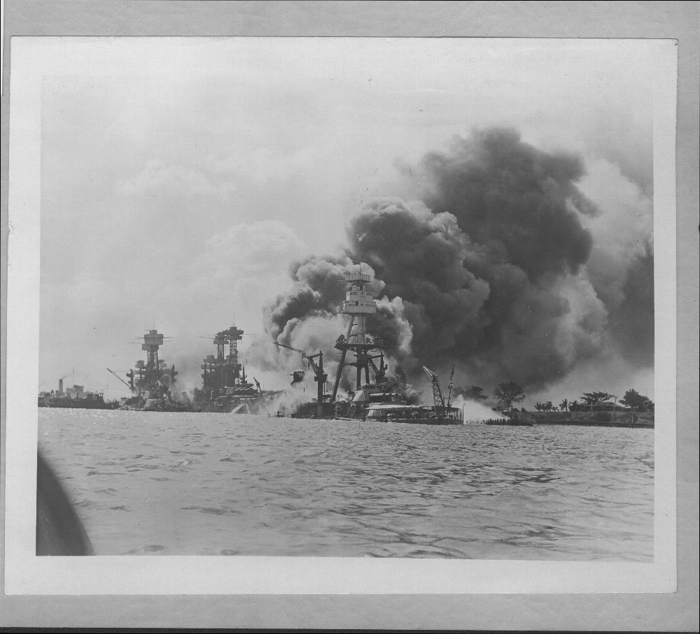 Attack on Pearl Harbor, Hawaii - The USS Arizona is in the foreground and the USS West Virginia and Tennessee are in the background.