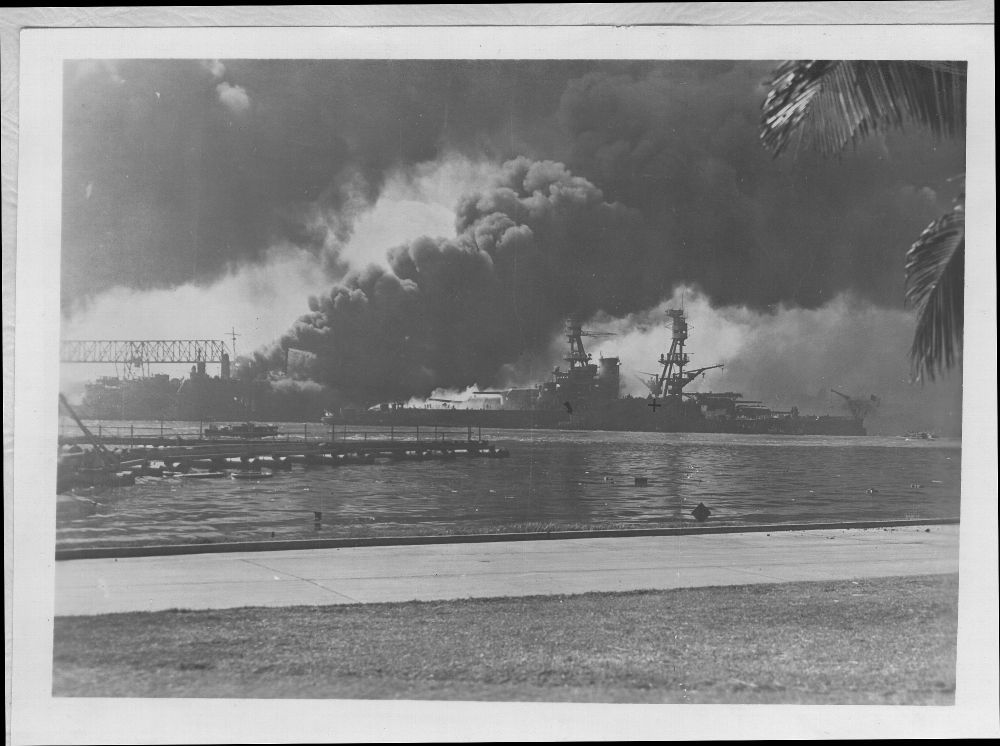 Attack on Pearl Harbor, Hawaii - On the left, are destroyers USS Shaw and USS Downs burning in drydock.   On the right, is the USS Nevada.