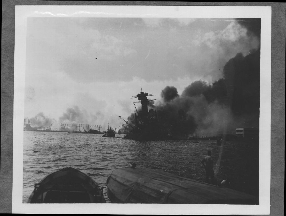 Attack on Pearl Harbor, Hawaii - Dense smoke coming from the USS California obscures Battleship Row.