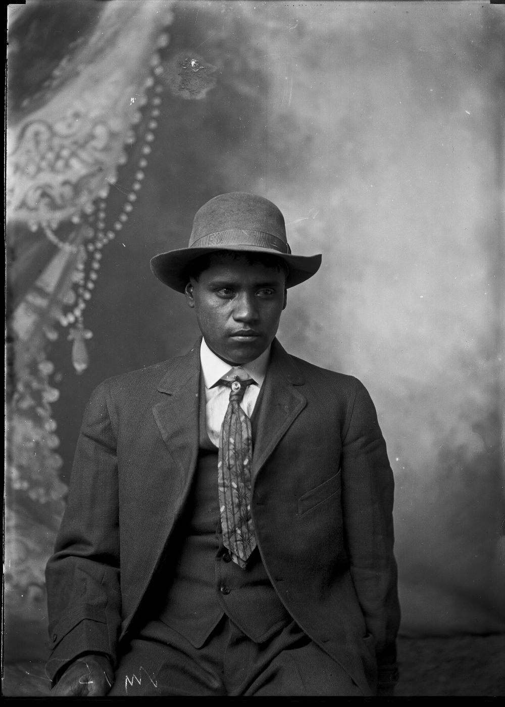 Portrait of a man in a hat and suit