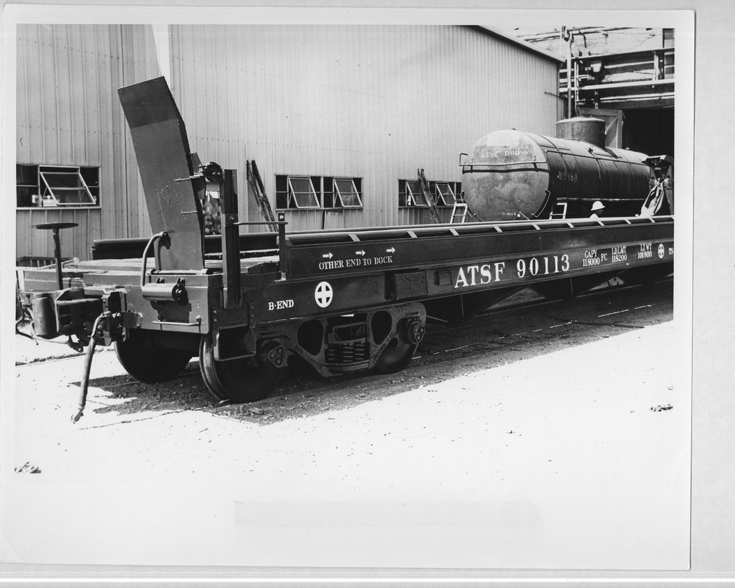 A trailer on an Atchison, Topeka, and Santa Fe flat car