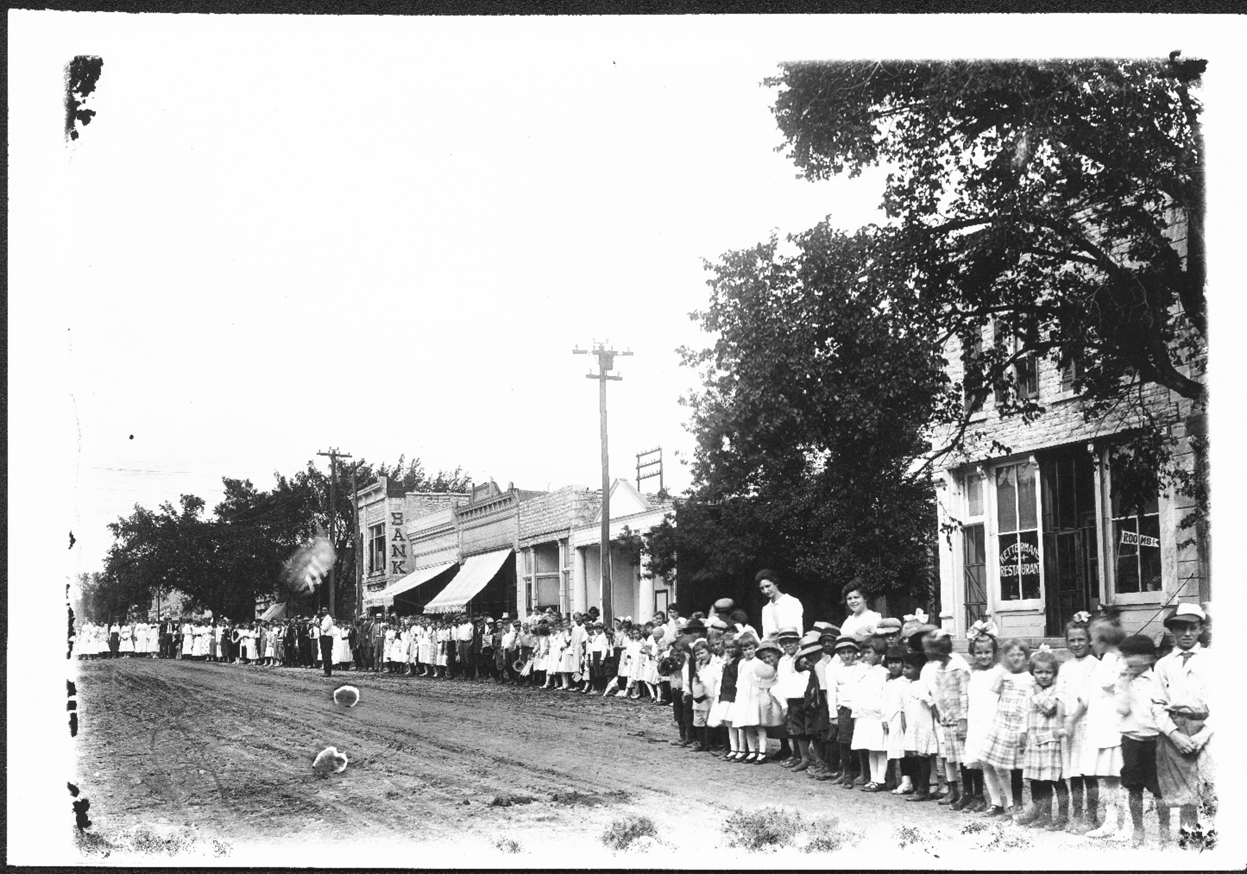 Adults and children gathered for a parade, Alma, Kansas