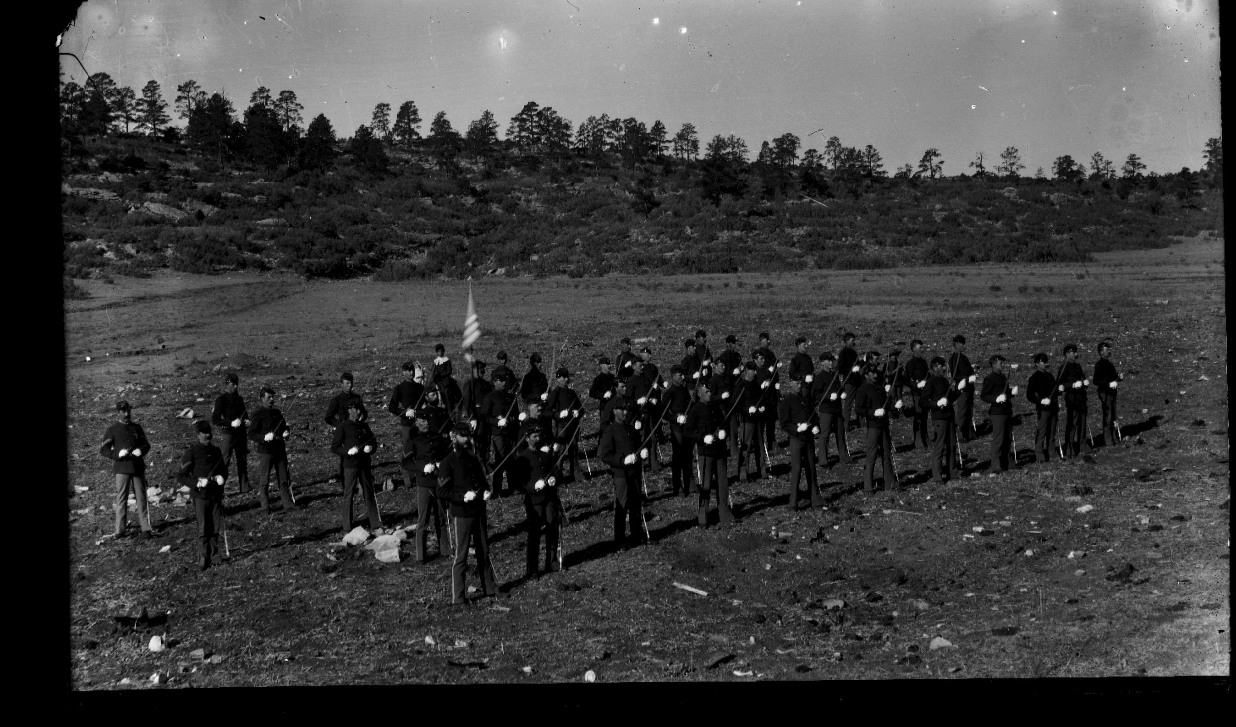 Fort Lyon and Fort Union - Troop E, 6th Cavalry stationed at Fort Union, New Mexico. Troops are lined up with swords. Neg #1
