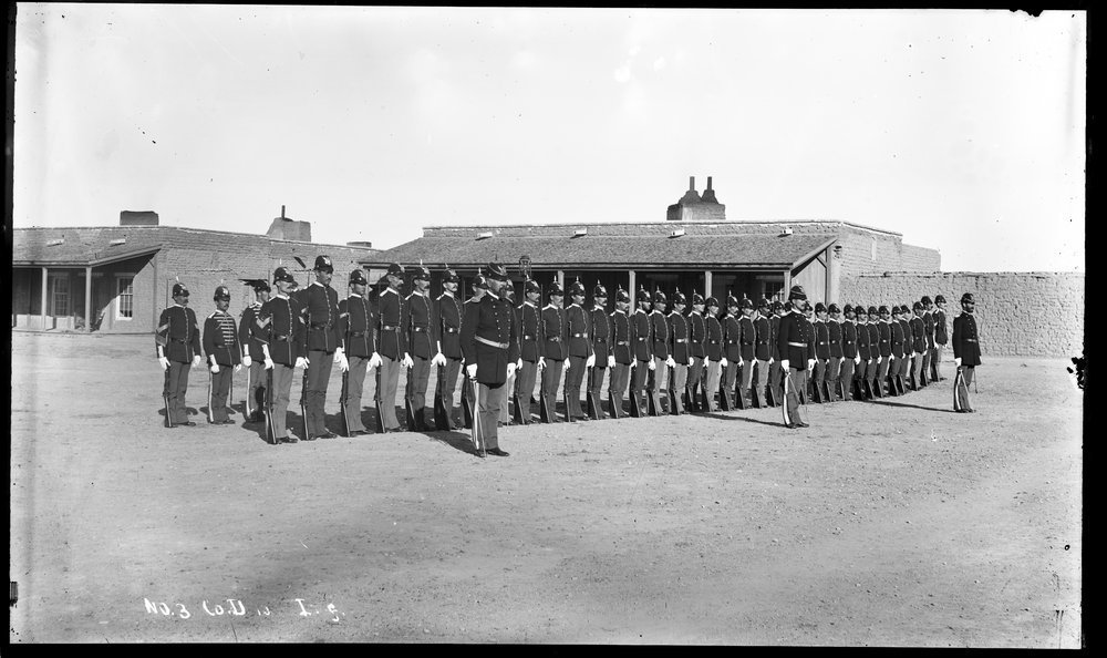Fort Lyon and Fort Union - Company D, 10th Infantry at Fort Lyon, Colorado. Soldiers are pictured in a line with their rifles. Neg #6