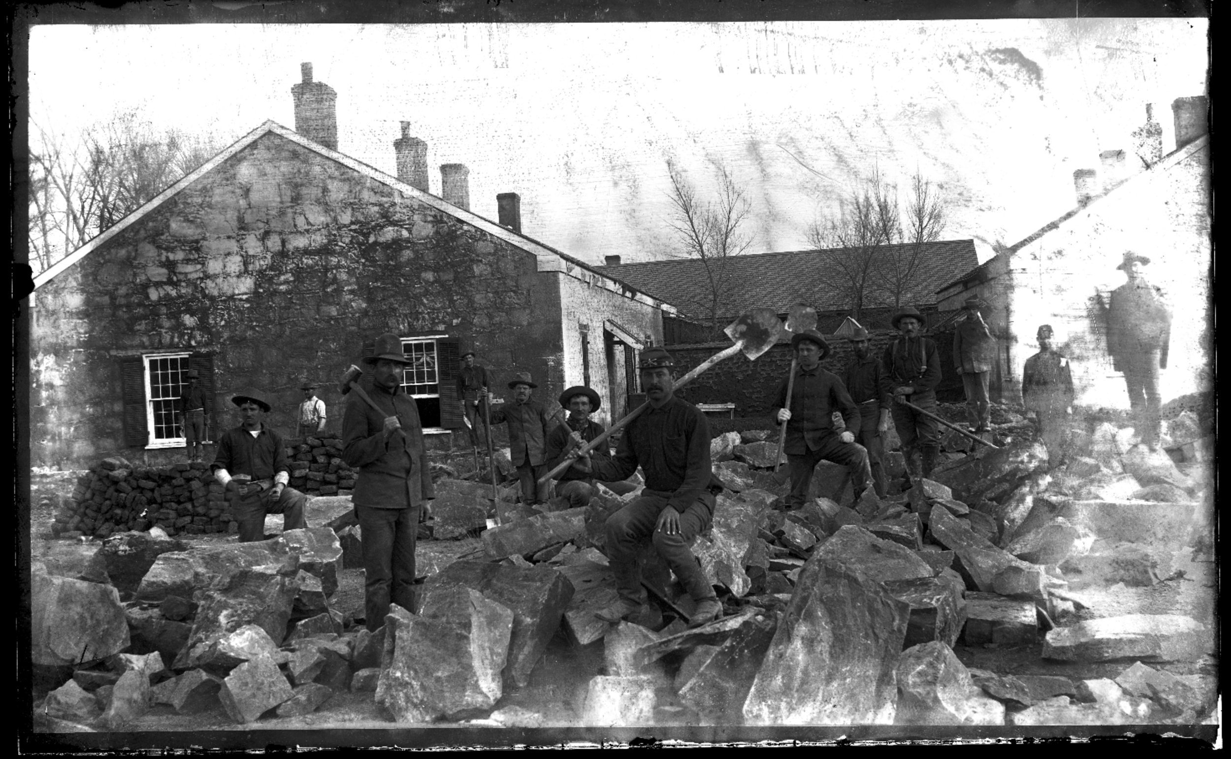 Fort Lyon and Fort Union - Unidentified soilders at Fort Lyon, Colorado. The soldiers are posed on top of a rock pile with shovels and hammers. Neg #9
