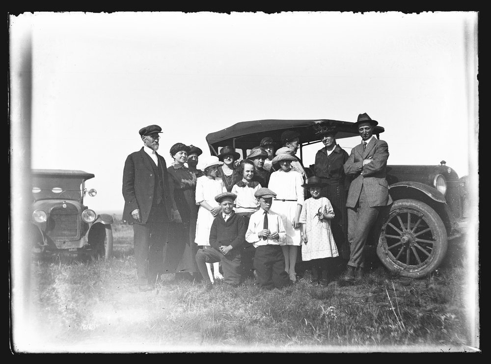 Golden Charles Dresher photograph collection - A group of people, mainly members of the Dresher family at a picnic, standing around two automobiles in Coronado Heights, McPherson County, Kansas in 1923 (Neg. 4)
