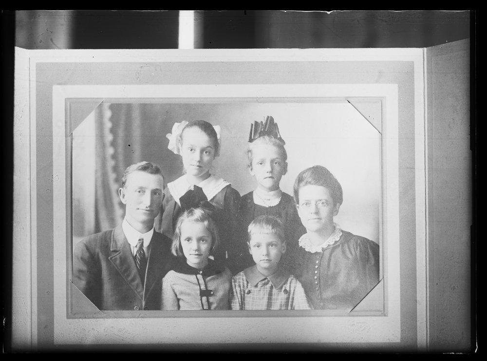 Golden Charles Dresher photograph collection - Copy of photograph, which shows a portrait of the Dresher family in Kansas in 1918.  Seated: Golden Charles (G.C.), Dorothy May, Donald Way, and Maude Way.  Standing: Margaret Helen, and Florence Pearl (Neg. 7)