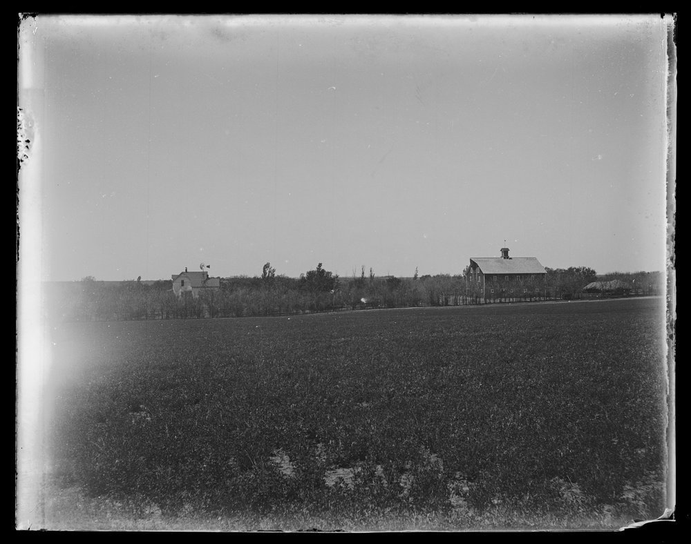 Golden Charles Dresher photograph collection - View of the J.N. and Sadie Dresher farm, barn, and property in Rice County, near Lyons, Kansas about 1900. (Neg. 10)