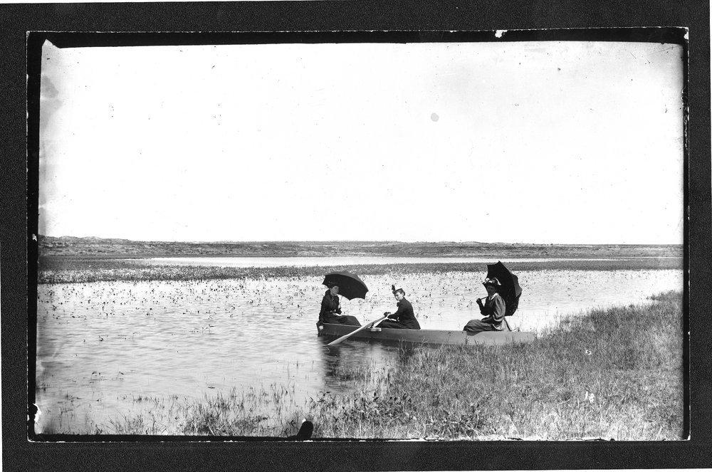 Women in a rowboat, Finney County, Kansas