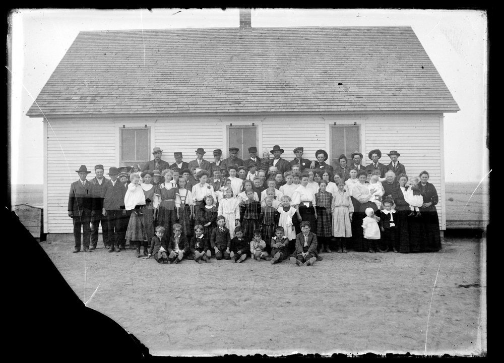 Golden Charles Dresher photograph collection - Large group gathered outside of school house in Finney, Scott, or Lane County, Kansas, in 1907-1909. (Neg. 326)