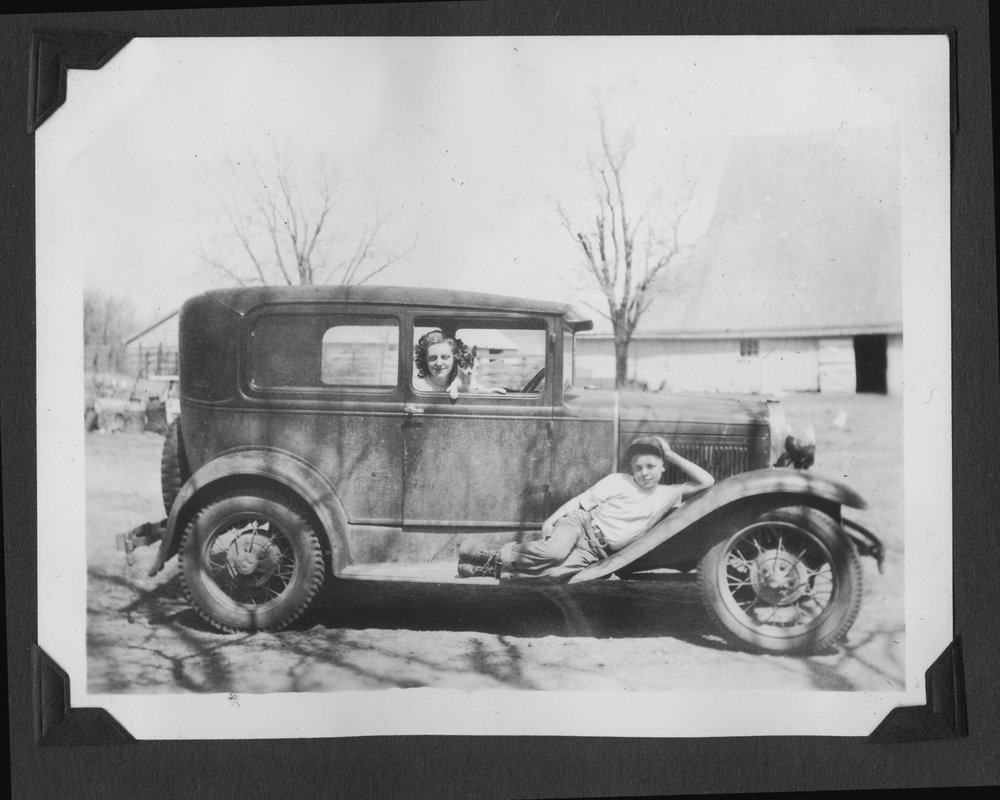 Melvin Brose photograph album - Charlene and Melvin Brose posed with the family's 1930 Model A Ford.