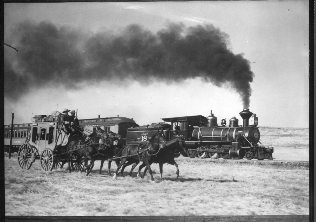 Atchison, Topeka & Santa Fe Railway locomotive #18 and a stagecoach