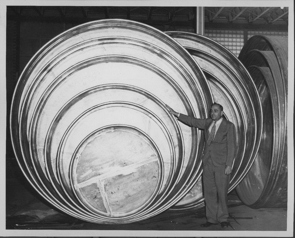Doerr Metal Products Company, Larned, Kansas - Man posing with products inside Doerr Metal Prducts, Larned, Kansas, 1940-1950s (Photo No. 5)