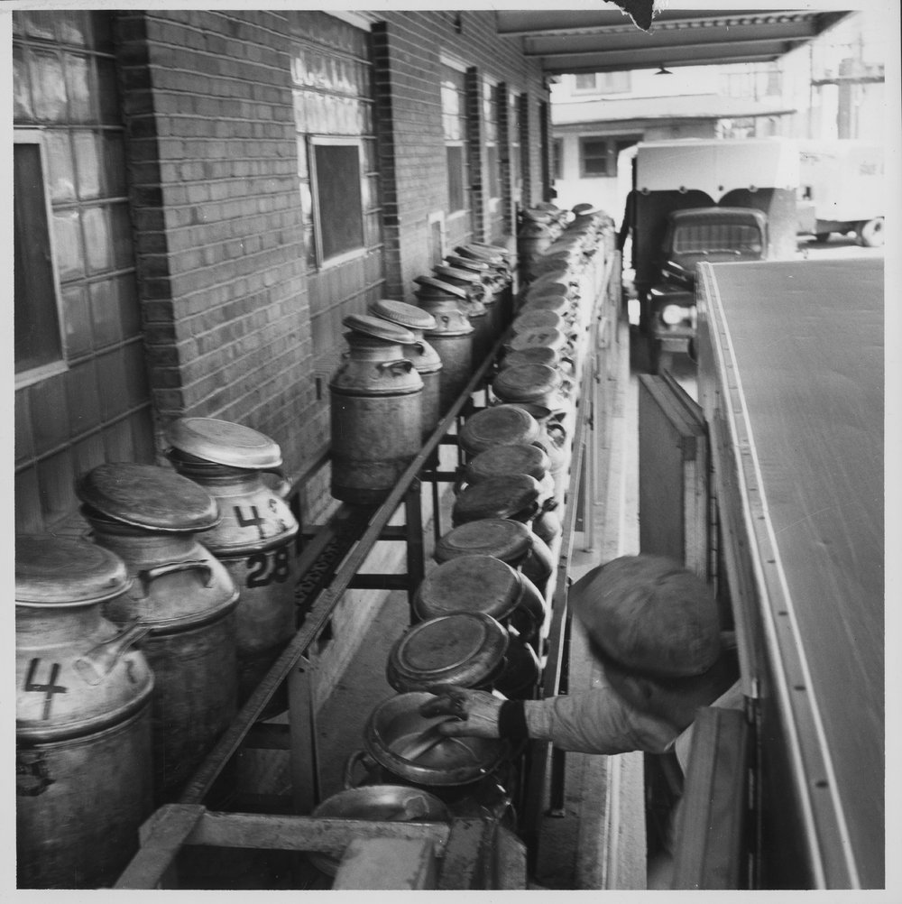 Dairy industry in Ottawa, Kansas - Milk cans on an assembly line in an unidentified company in Ottawa. Photo *1