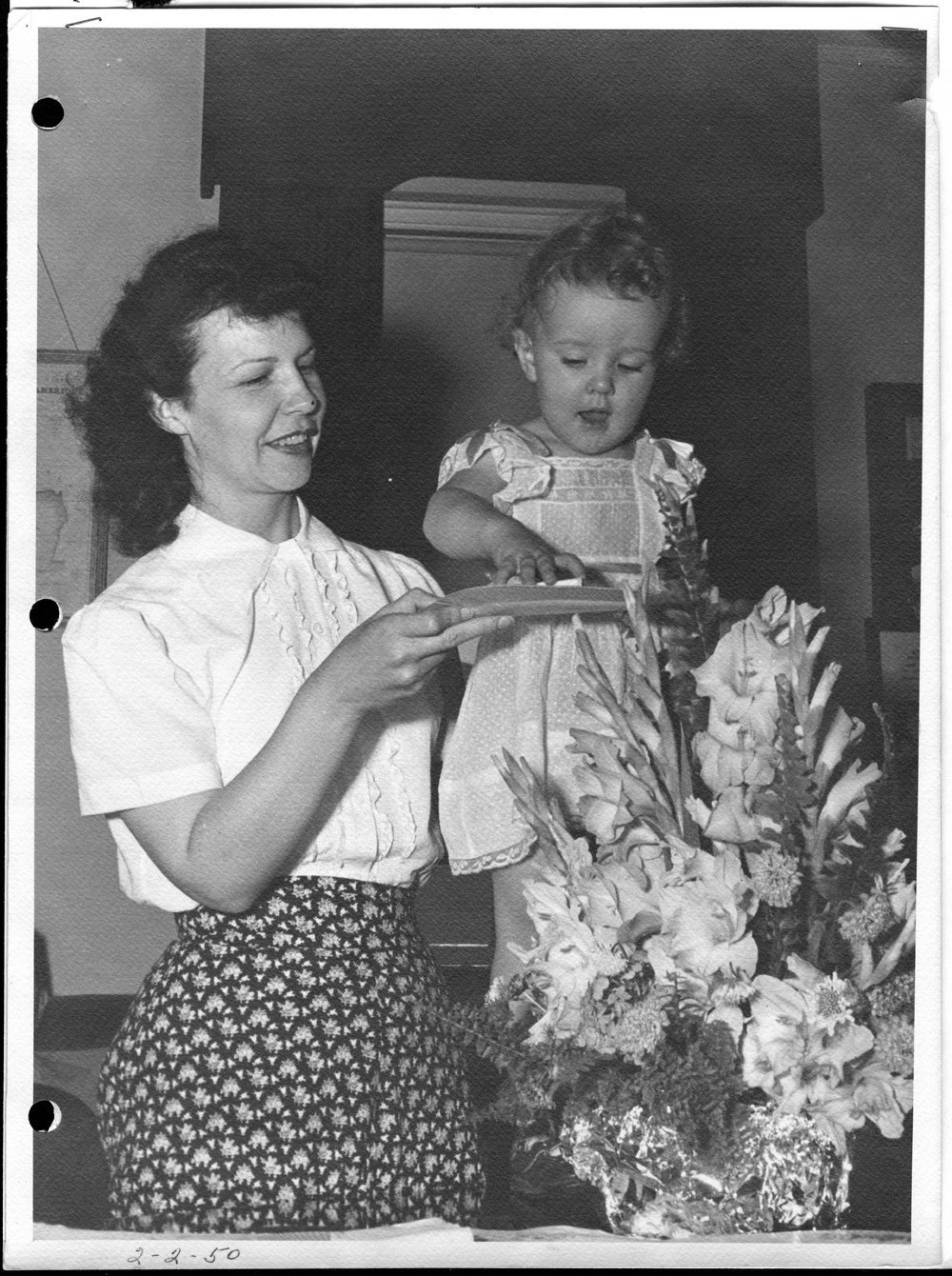 Dr. Karl Menninger - This photograph shows Rosemary on Dr. Karl's birthday.  Her mother Jean is serving her birthday cake.