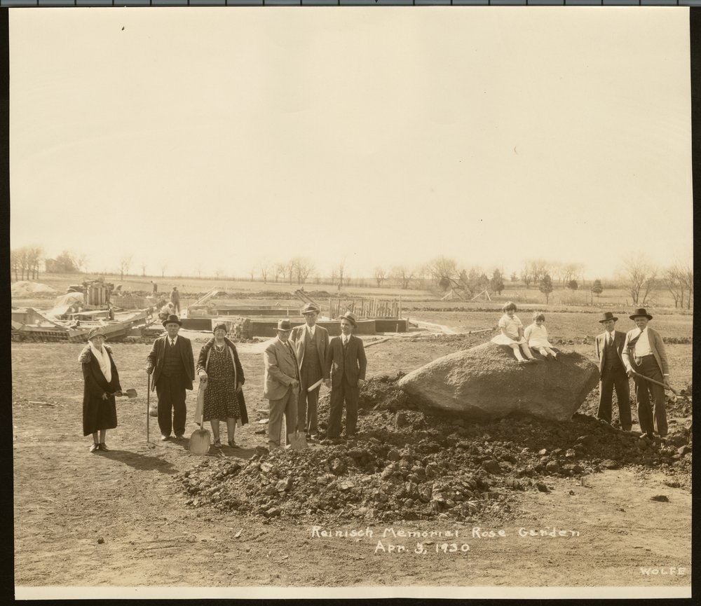 Dr. Charles F. Menninger and his interests - This photograph shows a granite boulder being placed in Reinish Memorial Rose Garden in Gage Park.  Dr. C. F. was a vigorous promoter of establishing the garden and helped select the roses for the planting of 4,800 bushes.