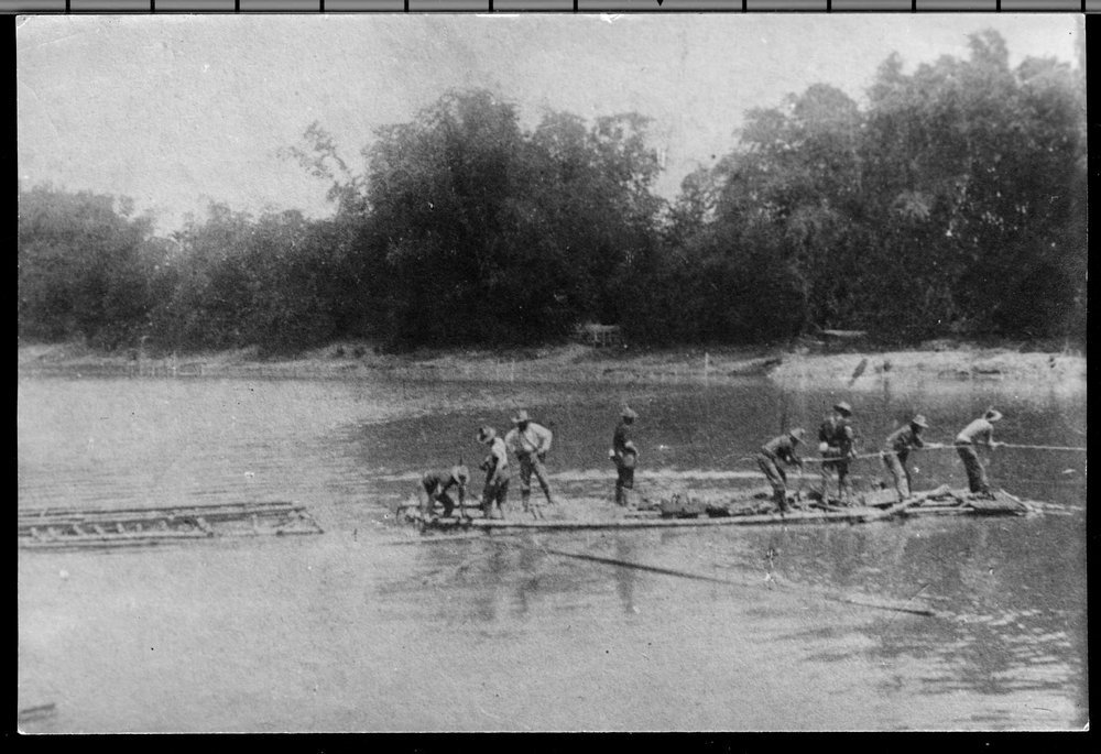 Crossing the Rio Grande de la Pampanga during the Philippine Insurrection - The first raft to cross the Rio Grande de la Pampanga in the Philippines.  Colonel Frederick Funston is second left at the rear of the raft.  *178