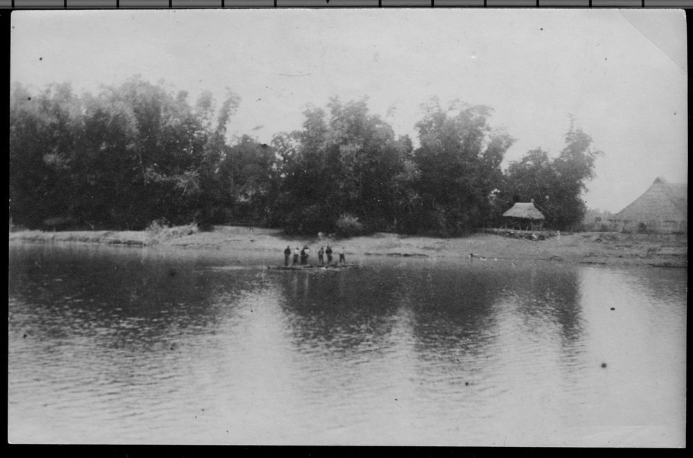 Crossing the Rio Grande de la Pampanga during the Philippine Insurrection - The first raft crossing the Rio Grande de la Pampanga carrying Colonel Frederick Funston.  At the time this photograph was taken, the rope broke and soldiers were trying to make repairs.  *180