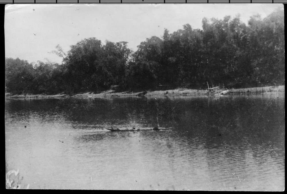 Crossing the Rio Grande de la Pampanga during the Philippine Insurrection - Tyler, front, and Kerfoot, rear, crossing the Rio Grande de la Pampanga after William B. Trembly and Edward White had taken the rope across the river.  This photograph was taken minutes before the canoe went under water.  *181