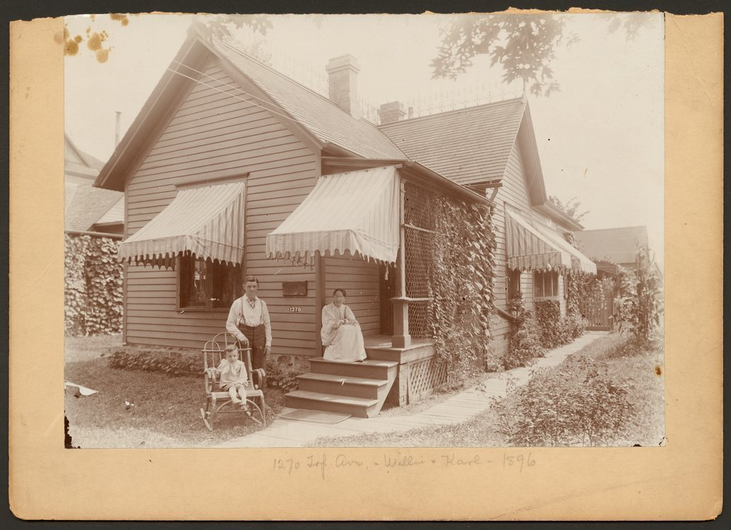 Charles F. Menninger homes in Topeka, Kansas - Family home of the C. F. Menninger family at 1270 Topeka Avenue in 1896. Karl is in the rocking chair and Willie is standing.  Flo is seated on the porch.