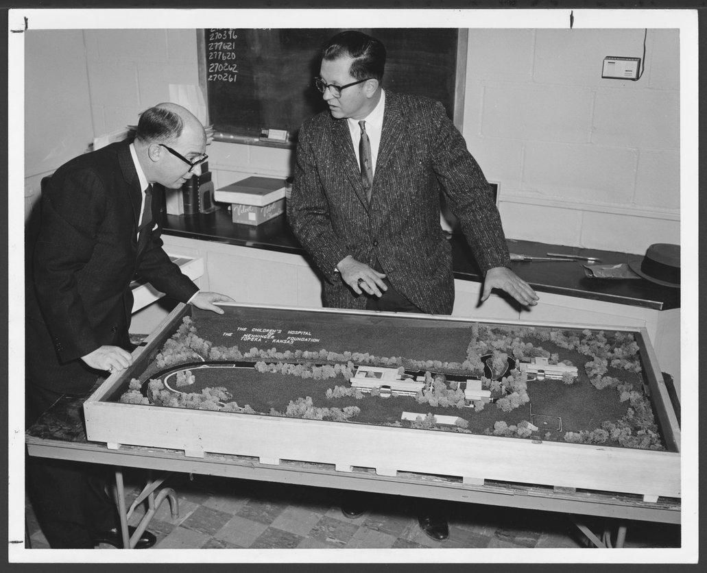 Menninger Children's Hospital, Topeka, Kansas, 1960-1962 - This photograph shows a model of the new Children's Hospital which was exhibited at the annual meeting of the American Orthopsychiatric Association.  Dr. Robert E. Switzer and  Basil E. Cole are inspecting it.  The model was constructed by William Imming