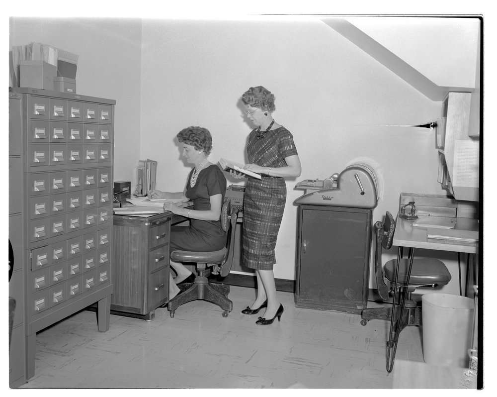 Medical library, Menninger's east and west campus - This photograph shows Virginia Eicholtz and Dorothy Pulliam in the east campus library about 1959.
