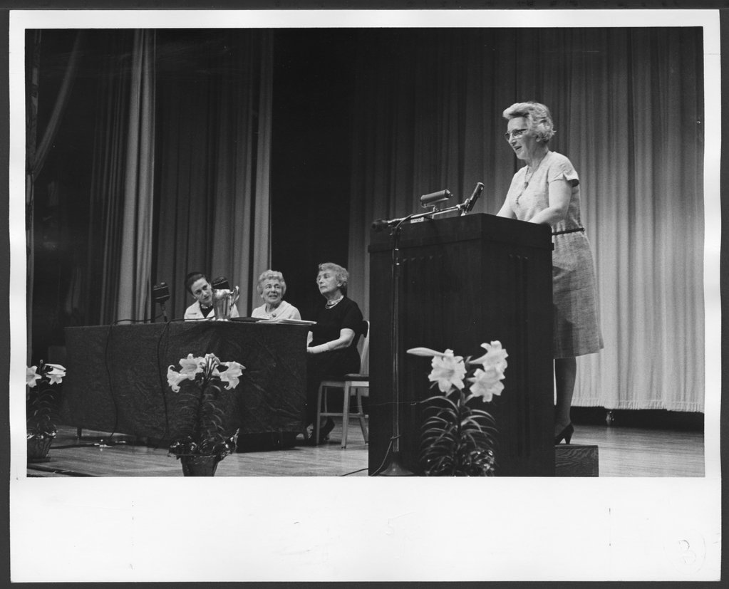American Association for Child Psychoanalysis first annual meeting in Topeka, Kansas - Dr. Marianne Kris, president, is greeting the members.  Also seated on the platform are Mrs. Erna Furman, Dr. Anny Katan, and Miss Anna Freud.