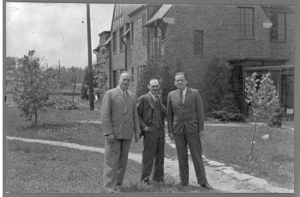 Menningers - Dr. Karl is pictured with Dr. Norman Reider and Dr. Bernard Kamm taken at the east end of the West Lodge in early spring, 1957.