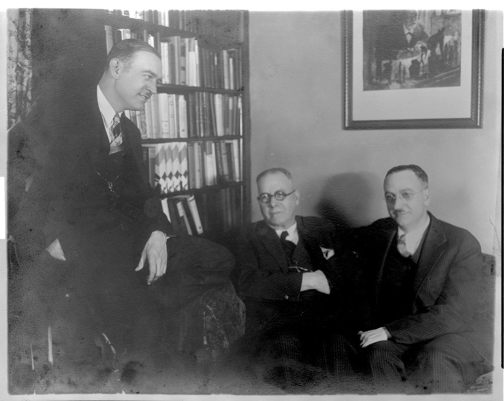 Menningers - This black and white photograph taken in Feburary 1930 shows Dr. Will, Dr. C. F. and Dr. Karl Menninger. ( Note the picture of Sigmund Freud at his desk.)