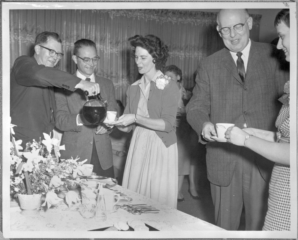 Secretaries' Tea at Menninger Clinic, Topeka, Kansas - The tea held in observance of National Secretaries Week.  Basil Cole and Tom Dolgoff are serving Kay Stoner.  Forrest Johanson and Jo Ediger are also enjoying the occasion.