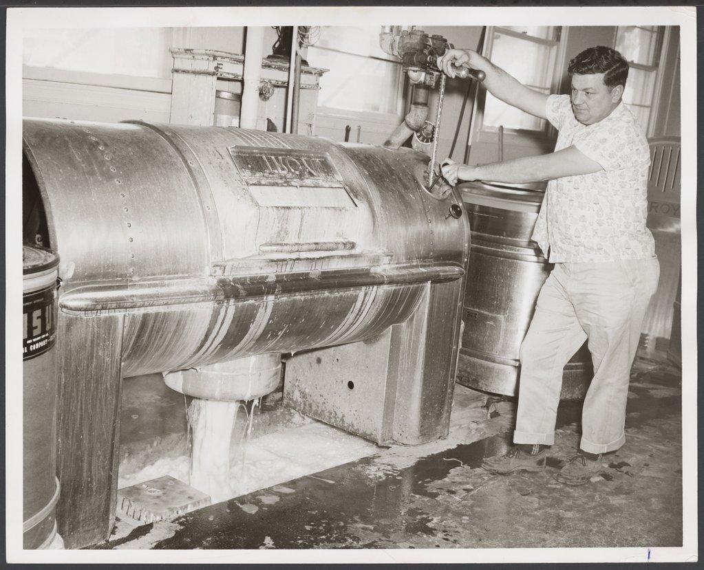 The laundry at the Menninger Clinic, Topeka, Kansas - Edward Hanshaw shows the 90 pound washing machine.