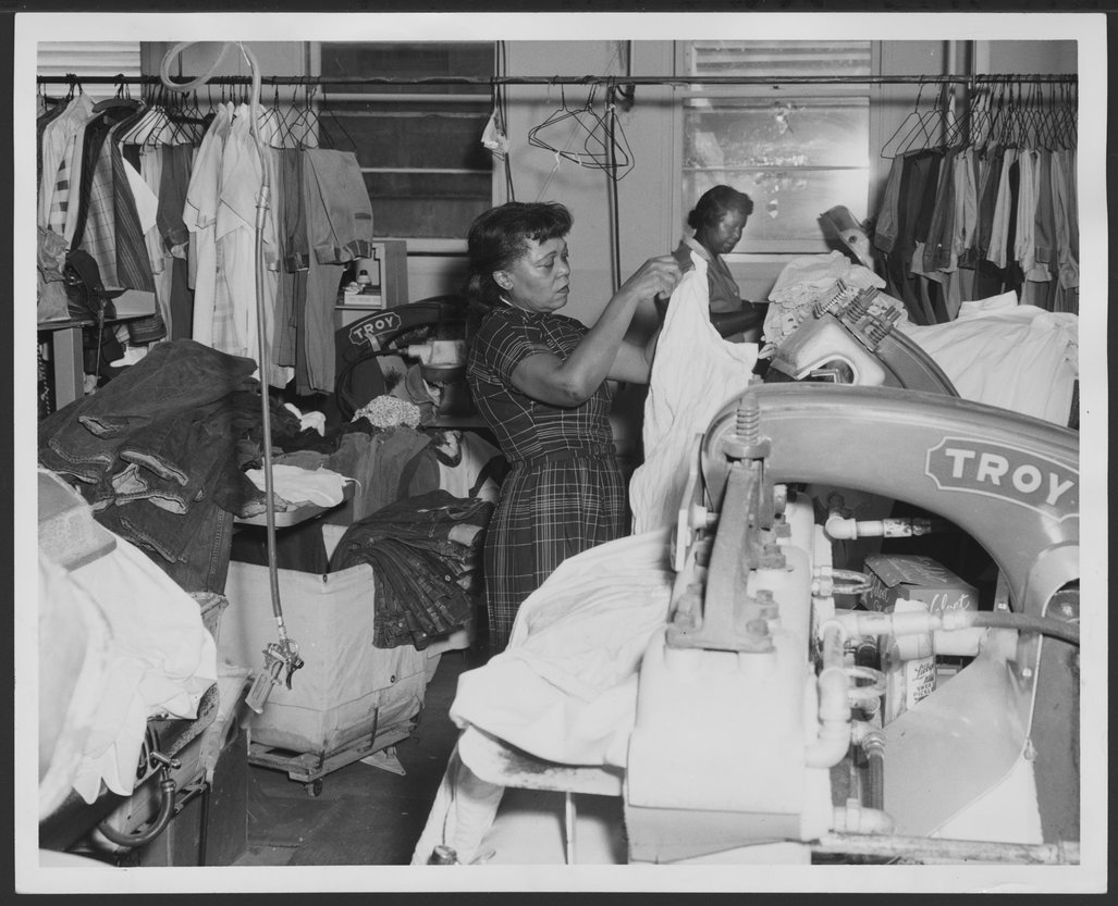 The laundry at the Menninger Clinic, Topeka, Kansas - Colleen Thompson and Ola Brown work the large presses.