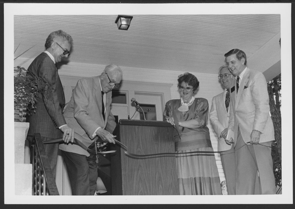 Heritage House in Topeka, Kansas - Dr. Karl cuts the ribbon to open Heritage House.  Left to right -- Betty and Don Rich, the new owners, and Dr. Roy, and Merle Blair, president of the Topeka Chamber of Commerce..