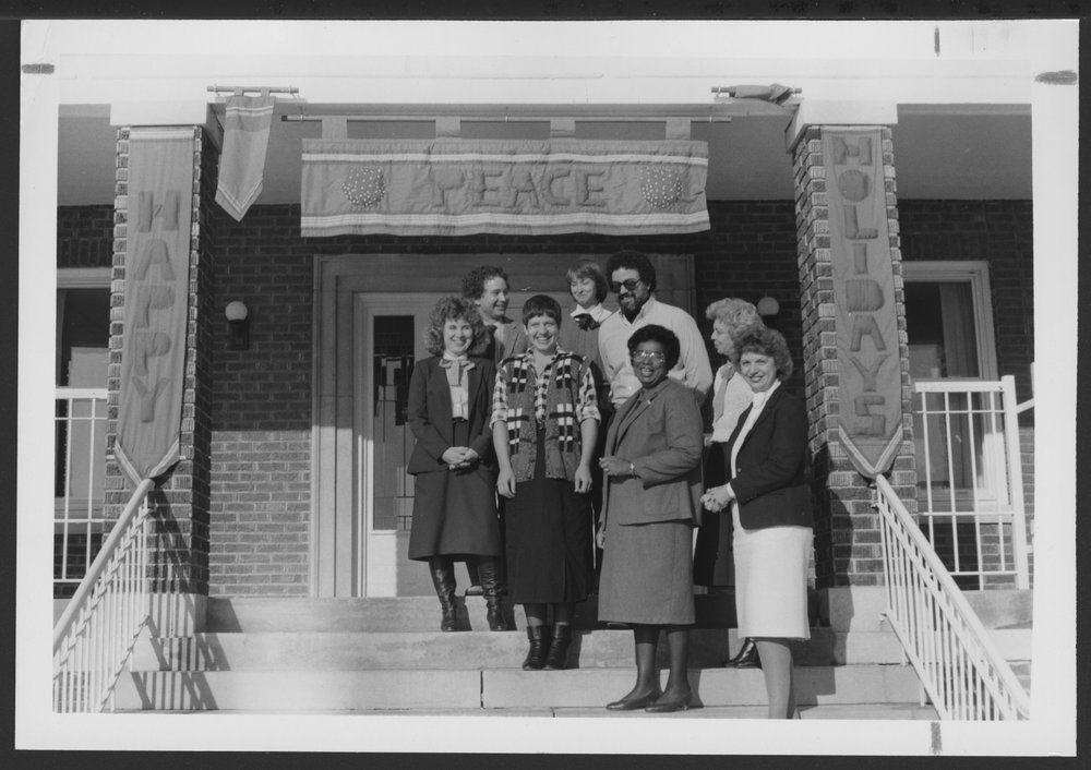 Christmas scenes at the Menninger Clinic in Topeka, Kansas - This photograph shows staff from the Partial Hospitalization Services on the steps of Clevenger Building ready for the annual Christmas Open House.