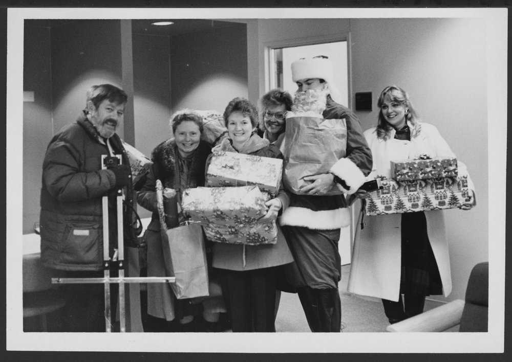 Christmas scenes at the Menninger Clinic in Topeka, Kansas - This photograph shows Human Resources staff with presents all wrapped and  ready for the adopted Christmas family.
